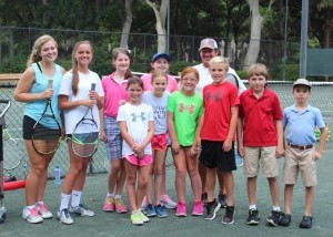 BA students Lauren Bartlett, Emma Grace Dinkins, Leith Gray, Campbell Dukes, Ansleigh Pingree, Witt Compton, Lucas Matte and G Simmons receive tennis instruction from Dataw Island tennis pro, Warren Florence, and instructors Addie Everidge and Hannah Verity.