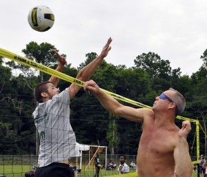 Jeremiah Polk, left, of Columbia, SC, tries to block the shot of Carlos Decker of Beaufort during the annual Beaufort Water Festival Volleyball Tournament.