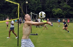 Dino Mullen of Beaufort sets up a shot with his back to the net during the Beaufort Water Festival Volleyball Tournament.