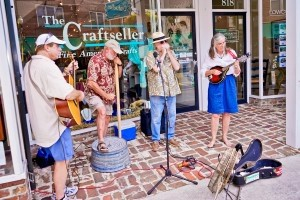 Local musicians play folk instruments in front of The Craftseller along Bay Street during last Friday's Art Walk, hosted by the Beaufort Art Association. Photo by Eric Smith of Captured Moments Photography.