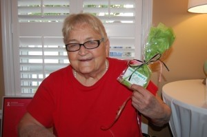 Elizabeth Entwistle holds up her gift from Green Fish Gallery.