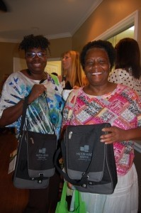 Inez Miller and Veronica Miller hold their insulated wine tote bags from Hilton Head Hospital.