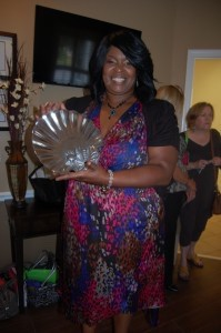 Lavonia Miller displays her silver tray from Modern Jewelers.