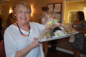 Tina Peterson shows off her gift basket from Riverside Women's Care.