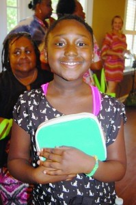 Adorable Ashalia Birney, 9, won a cosmetic case and gift certificate from Halo Salon.