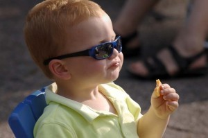Bryson White, 2-year-old son of Robbie and Cyndi White of Fripp Island, helps himself to fresh fruit prior the start of the concert.