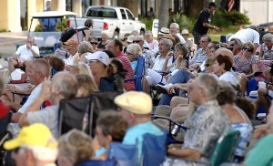 A large crowd attends the popular Street Music on Paris Avenue concert.