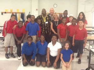 Center left: Prosper Ndabishuriye. Center right: Angie Patterson surrounded by her fifth grade students at Beaufort Elementary. At back: Mike Seymour, Compassionate Beaufort Communities member.