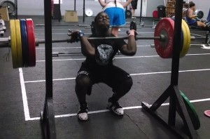 CJ Cummings, 14, is seen during a recent training session at CrossFit Beaufort performing a 170 kg (375 pound) front squat. CJ is preparing for the USAW Senior National Weightlifting Championships in Salt Lake City, Utah.