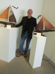 Artist RL Brethauer with his ships built from recycled materials.