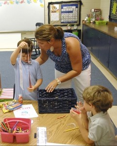 Bradi Dinkins, a first grade teacher, makes sure her students have snacks on the first day of school.