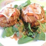 Southern fried green tomatoes on top of baby spinach greens