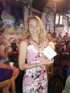Elizabeth Bergmann shows her $25 gift certificate for dinner at Lady Island Country Club's Tavern in Royal Pines.