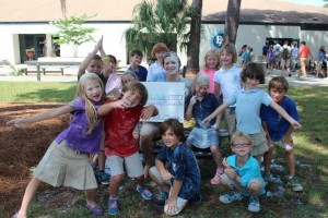 Beaufort Academy's 2nd grade teacher, Mrs. Abby Mitchell, took the ALS Ice Bucket Challenge.... with a twist for SMA (spinal muscular atrophy) which affects Mrs. Mitchell's friend, Leo. Mrs. Mitchell challenged each of her 2nd graders to raise money for the opportunity to douse her with water and flour bomb her — and they rose to the challenge! This group raised $350, which will be donated to Leo's Pride, and Mrs. Mitchell wore 13 buckets of water and a bucket of flour.  Great job 2nd grade, the school is so proud and inspired by you and your teacher.