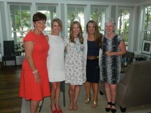 From left: Michele Barker, Courtney McDermott, Emily Harris, Becky Cunningham and Sallie Stone, who hosted the baby shower at her home on Distant Island.