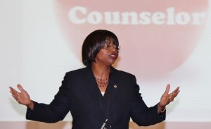 New school district lead Counselor Geri Henderson speaks to counselors from each school in the district before the start of the 2014-15 school year.