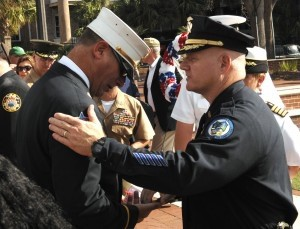 City of Beaufort Police Chief Matt Clancey, right, greets Battalion Chief David Simms of the New York Fire Department last Thursday following the September 11 observance at the Henry C. Chambers Waterfront Park. Battalion Chief Simms gave a first-hand account of his experience as a NYFD firefighter on 9-11. Photo by Bob Sofaly.