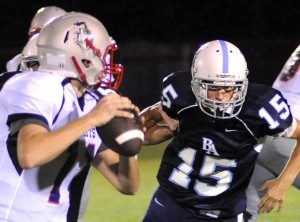 BA's William Gallant, right, keeps his eyes on the Faith Christian quarterback during last Friday's one-point loss, 43-44.