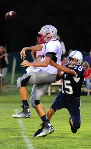 Beaufort Academy's William Gallant puts pressure on the Faith Christian's quarterback during the second quarter last Friday night at Merritt Field.