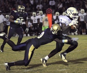 Beaufort High's Jawan Mack catches a pass for a short gain during the first half of last Friday's night at Battery Creek High.