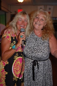 MC Irene Goodnight shares a laugh  with the local karaoke singer.