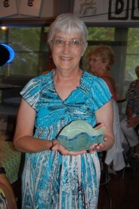 Nancy McHale holds up the pottery  she won from The Craftseller.