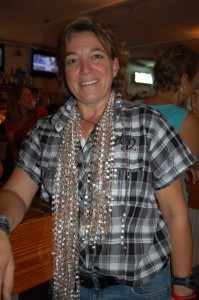 Deb Duer wears the scarf she won from Fordham Market.