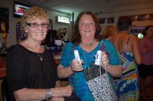 Jan Hughes, right, shows off the items inside her gift bag from Pinnacle Plastic Surgery.