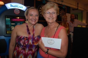 The Island News' Kim Turner poses with Rita Hunt, who won a gift certificate from Bellavista.