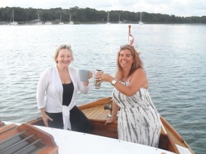 Kim Turner and Nikki Hardison toast their coffee mugs to the beginning of a glorious new day.