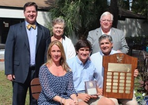 Sitting at center is 2014 recipient Todger Davis, his father Tad Davis at right, and step-mother Selma Lovett at left. Standing is scholarship presenter Clark Robinson and his parents, Betsey and Bill Robinson.
