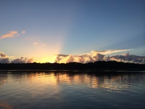 The view from the boat as morning begins to break and the sun peeks over the horizon.