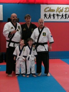 From left: David Spears, Club Karate owner Chuck Elias, Charlie Spears, and David's twin boys in front.