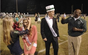 2014 Homecoming: Alex Zapp, second from left, is crowned the 2014 Beaufort High School Homecoming Queen by Elise Dean. King of Court was Zach Wilson, center, crowned by BHS principal Cory Murphy.