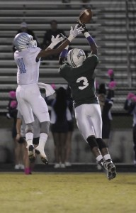 Hilton Head receiver Aaron Frazier, left, can't jump high enough as Beaufort's Malcolm Simmons breaks up the play during the first half Friday night at Eagle Stadium.