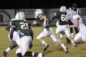 Wyatt Sherpensky, center, finds a big opening in the Hilton Head defense and punches through it to score a touchdown. Photos by Bob Sofaly.