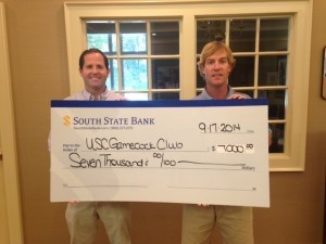 The Beaufort County Gamecock Club presented a check for $7,000 to the USC's Gamecock Club in Columbia. At left is Phillip Lynn, President of the Beaufort Club, with Neal McCarty, club vice president.