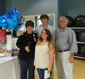 Kim Raines' daughter Addison, son Jordan and husband David joined her co-workers for the surprise presentation of the DAISY Award at Beaufort Memorial's LifeFit Wellness Center.