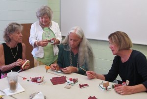 Micemakers (from left, Judy Adams, Teresa Roundy, Becky Werkheiser and Carol McCorey) are hard at work.