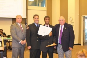Pictured at right, from left: Superintendent Jeffrey Moss, Burton Engineer/Paramedic Daniel Byrne, Battery Creek High School student Tyrik Kelly, and School Board Chairman Bill Evans.