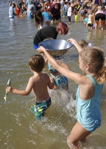 Elle Bougan, 7, found it was more fun to play in the water with the colander than sift for shark teeth, but she did find a few small teeth.