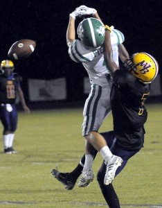 Whale Branch's Brylon Harrison, right, breaks up a deep Bishop  England pass during Region-AA play.