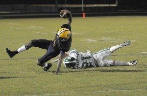 Whale Branch's David Lamb makes an extra effort to stay on his feet for extra yards against Bishop England.