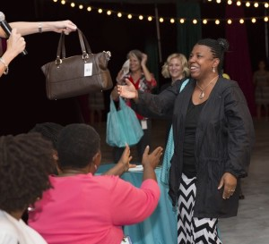 Tiffany Cuylear won a Kate Spade handbag, the grand prize of the event.