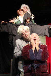 """Ebenezer Scrooge (Alan Lathan) suffers the torments of (from top) the ghosts of Christmas Past (Henry Dreier), Present (Matthew Osbourne), and Future (Christian Osbourne) and his chain-bound partner, Jacob Marley, in Misspent Youth's production of Charles Dickens' """"A Christmas Carol."""" Adapted and directed by Travis Marshall Hornsby, the play runs at ARTworks November 28-30 and December 4-6. For tickets, call 843-379-2787 or visit www.beaufortcountyarts.com. Photo by Heather Szeder."""