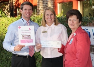 Lisa Garber, center, a breast cancer survivor, presents a $1,000 check from Winning Orthodontic Smiles to Connie Duke, Cancer Program Director for the Keyserling Cancer Center for Breast Cancer Research.  The $1,000 resulted from 200 orthodontic patients sponsoring the fundraiser by wearing pink braces for Breast Cancer Awareness month. Pictured on left is Dr. Travis Fiegle, co-owner of Winning Orthodontic Smiles.