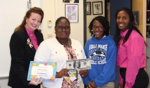 Winning Orthodontic Smiles presented Whale Branch Middle School's Social Studies teacher, Felicia English (left center), $100 for classroom supplies after student Chyla Simmons, (right center) entered her in the Favorite Teacher Contest held by Dr. Skeet Burris and Dr. Travis Fiegle. Also pictured are Dawn Cherami (left) and Ann Paige (right) representing Winning Orthodontic Smiles.