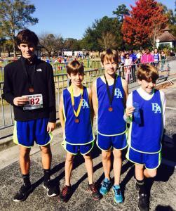 Pictured from left: Four BA runners — Mitchell Russell, Cameron Keenan, Nathaniel Keenan, and Jack Carter Worrell — qualified for nationals at the championship race.