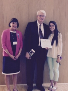 Charles E. Holbrook (center), of Beaufort High School, was selected as the Thomas Heyward, Jr., Chapter, NSDAR, 2015 Outstanding Teacher of American History and was presented with a certificate by chapter Regent Harriett Bosiack (left).  Mr. Holbrook teaches American History and AP History.  His nomination was sent forward to compete at the state SCDAR level. Also pictured is Elizabeth Crowther, right, a former student of Mr. Holbrook. Photo by Charlene Shufelt.