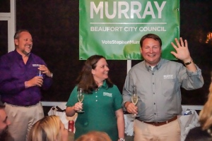 After a four-person race for two positions on the Beaufort City Council, Stephen Murray, right, celebrates Tuesday, Nov. 4, with his wife Melissa and a crowd of supporters after winning a seat. The second seat was filled by Phil Cromer. Photo by Eric Smith.